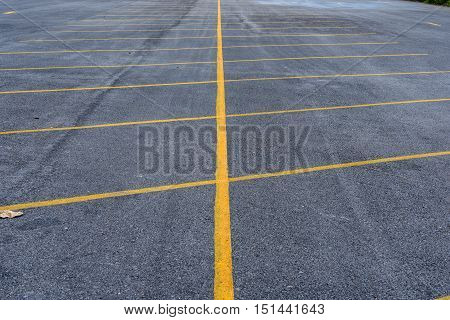 empty parking lot with yellow line mark