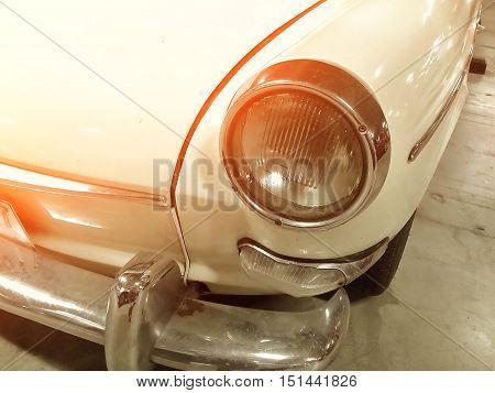 Retro headlight of vintage car vintage light effect