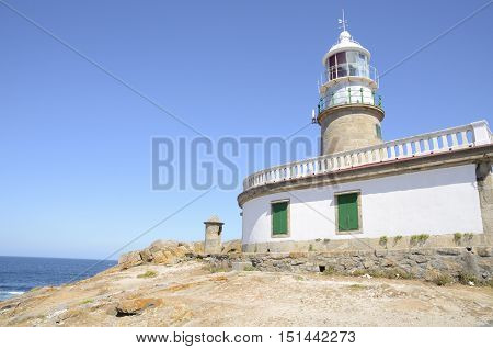 Lighthouse in the coastline of Corrubedo Galicia Spain