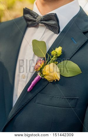 Wedding boutonniere on suit of groom.