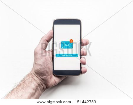 Close up of smartphone with Email app interface on screen holding in man's hand