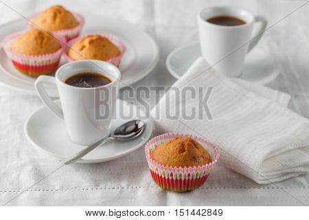 Fresh muffins on the table with napkin
