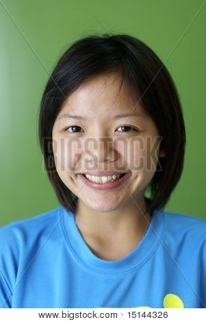 Smiling female asian teen