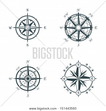 Set of vintage or old different style like globe and arrows compasses for west and east, north and south navigation. Perfect for marine and nautical, ship and topography, maritime theme