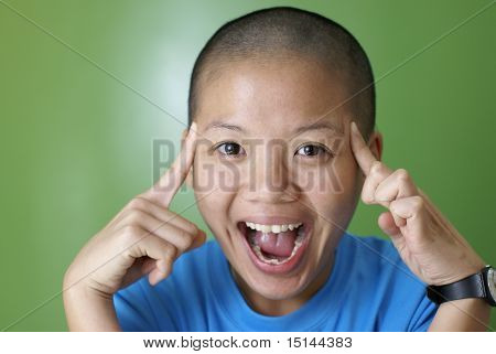 Happy asian girl point at bald head