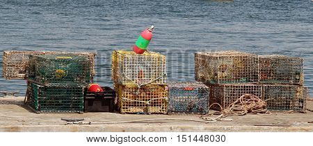 Lobster traps and buoys on a dock in Bar Harbor, Maine