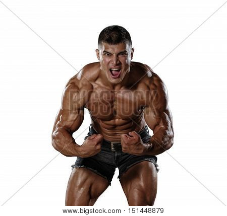 Muscular man in a state of aggression. Isolated.