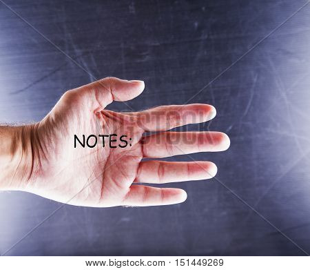 Notes written on male hand horizontal image