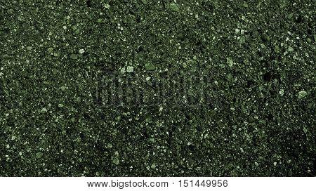 Asphalt, asphalt texture, scabrous asphalt background, asphalt pattern, abstract background, abstract texture, coloured dark asphalt texture, green abstraction, grunge texture