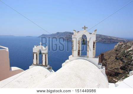 Bell towers of a chapel Oia Santorini Greece.