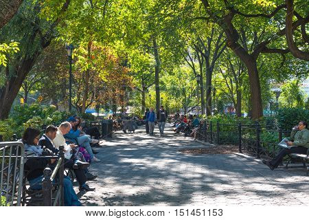 Union Square East, New York, US --October 11, 2016. New Yorkers relaxing in Union Square Park on a beautiful Autumn day. Editorial Use Only.