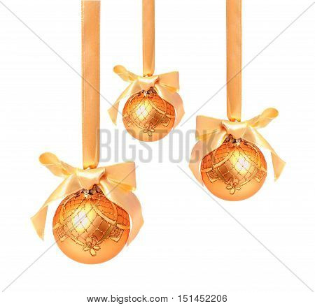 Hunging golden christmas balls isolated on a white background