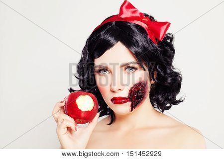 Halloween Concept. Woman with Wound and Poison Apple