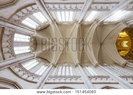 Vaulted Ceiling Of A Church With Windows And Dome