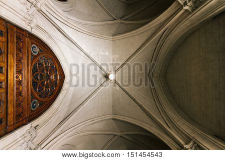 Vaulted Ceiling Of A Church With Wooden Door
