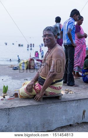 Rameswaram, Tamil Nadu, India - May 25, 2014. Full report about Rameswaram pilgrimage, religion. Religious city rituals. Priest on the beach side, offerings, prayer