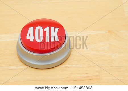 A 401k red push button A red and silver push button on a wooden desk with text 401k
