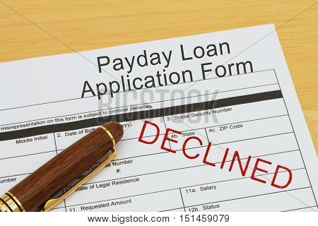 Applying for a Payday Loan Declined Payday loan application form with a pen on a desk with an declined stamp