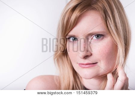 beautiful blonde woman looking into camera and dreaming