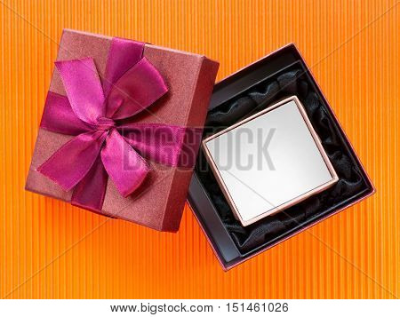 Open nested gift boxes on bright orange corrugated cardboard. Top view. Clipping path included