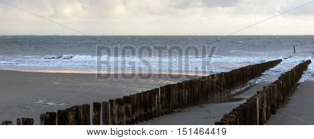 coastal scenery with wooden pillars in the Netherlands