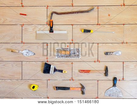 House renovation tools  on yellow ceramic background top view