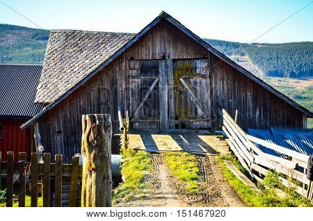 wooden farm house in morning sun norway