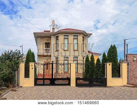 Beautiful two-storied cottage behind the metal gate in Odessa Ukraine