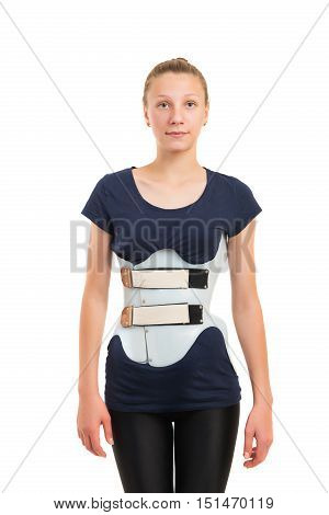 teenage patient in a corset Chenault isolated on white background. Treatment scoliosis.