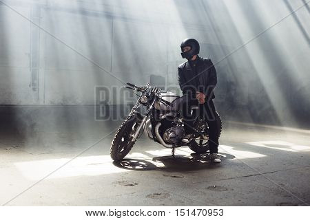 Biker Wearing Jeans And Leather Jacket Sitting On Motorcycle