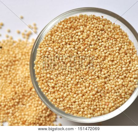 Amaranth seeds in a glass bowl, top view, close-up