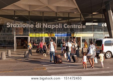 Naples Italy - August 6 2016: Piazza Garibaldi Central Station some tourists enter with suitcases in Naples train station by the main entrance.