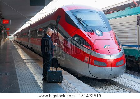 Naples Italy - August 6 2016: Central Station in Piazza Garibaldi a driver waiting on the station platform before starting his work on high-speed train.