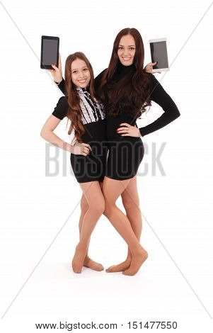 Two girls keeps tablet pc standing sideways isolated on white