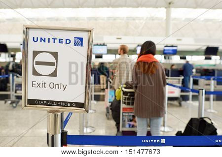 HONG KONG - NOVEMBER 03, 2015: United check-in counters at Hong Kong Airport. Hong Kong International Airport is the main airport in Hong Kong. It is located on the island of Chek Lap Kok.