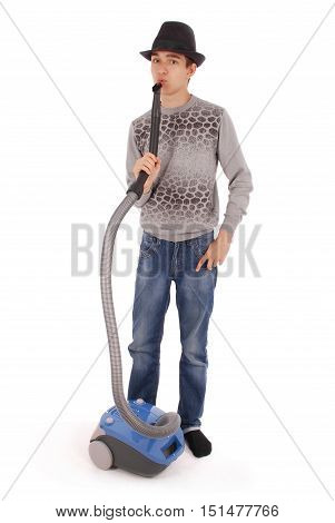 Boy in a hat holding a vacuum cleaner isolated on white background