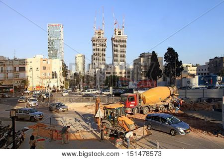 TEL AVIV, ISRAEL - APRIL 07, 2016: view of road construction work site with construction machinery in Tel Aviv, Israel