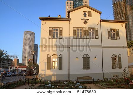 TEL AVIV, ISRAEL - APRIL 7, 2016: View of open air commercial center Sarona over skyscrapers of Azrieli Center, Tel Aviv, Israel. Recently open Sarona Market became the most popular place in Tel Aviv. Sunset light