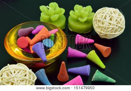 colorful incense or frankincense with candle (soft focus,lens blur)