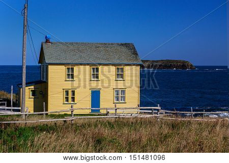 Traditional home along the rugged shores of Newfoundland, Canada.