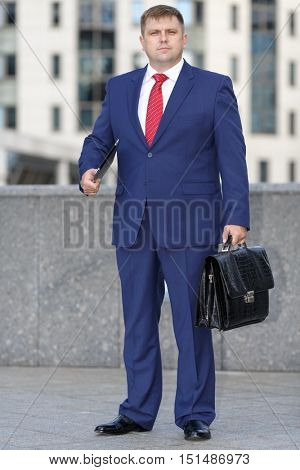 Successful business man, mature looking, in city business district