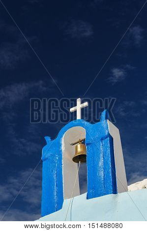 Blue and white orthodox church bell tower. Oia, Santorini Greece. Copyspace