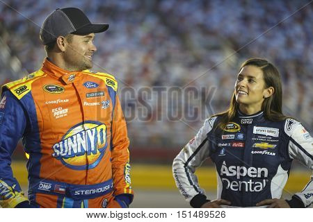 Concord, NC - Oct 06, 2016: Ricky Stenhouse Jr. (17) and Danica Patrick (10) wait to qualify for the Bank of America 500 at the Charlotte Motor Speedway in Concord, NC.