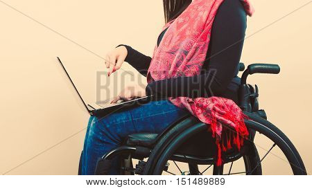 Crippled person with laptop. Young disabled female surfing on web. Internet technology education disability concept.