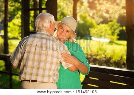 Old couple is dancing. Smiling senior lady. Years go but love remains. You're all that I have.