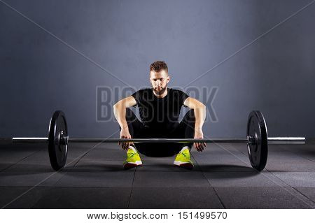 Athlete relax before barbells exercise at gym