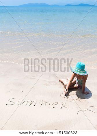 little girl child swinging in hammock on the beach eyes closed sea ocean