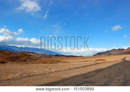 Road in Death Valley National Park on cloudy, California, USA.