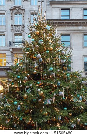 Beautiful Christmas Tree With Gifts and Icicles in City