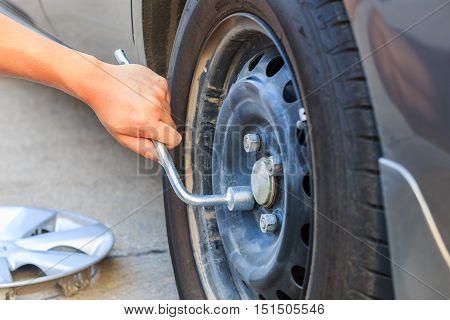 A hand of mechanic changing car wheel